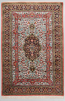 A RUG, old Silk Qum, around 203 x 133 cm.