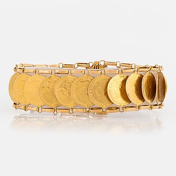ARMBAND, 21K guld bestående av brittiska mynt på rad.