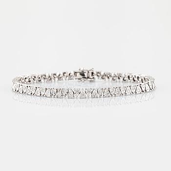 BRACELET, with briljantslipade diamanter.