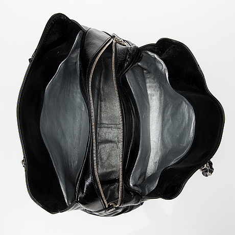 A black patent leather shopper.
