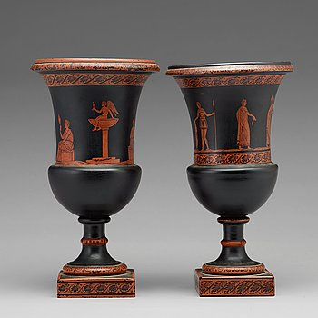 A matched pair of red figure glass vases, late empire, second half of 19th Century.