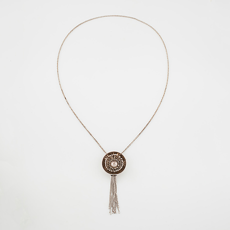 Rosa taikon, stockholm, 1984, a necklace.