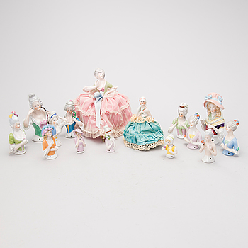 15 porcelain half dolls / pin cushion dolls, the first half of the 20th century.