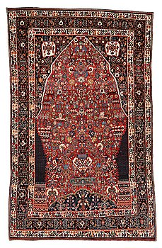 214. A CARPET, a semi-antique Qashqai, ca 265,5-268 x 169,5-171 cm (as well as one end with 2 cm flat weave).
