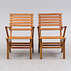 A pair of garnde armchairs by carl malmsten