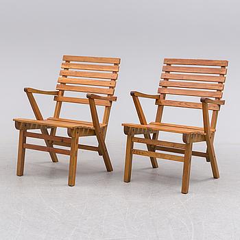 CARL MALMSTEN, A pair of garnde armchairs by Carl Malmsten.