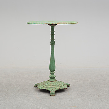 A circa 1900 iron table.