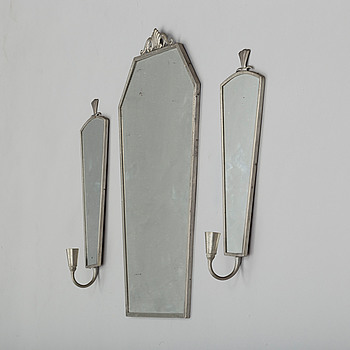 A 1920's/30's pewter mirror with two wall sconces.