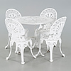 A garden table and four chairs from the latter half of the 20th century