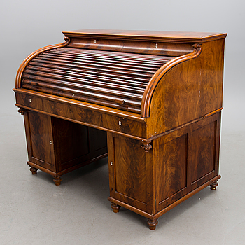 A mid 19th Century mahogany rolltop writing desk.