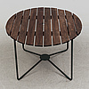 A garden table and 4 chairs 20th century
