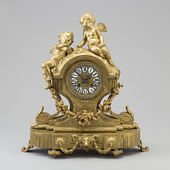 A late 19th century French brass mantle clock.
