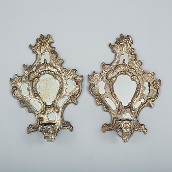 A pair of 19th century baroque style wall sconces.