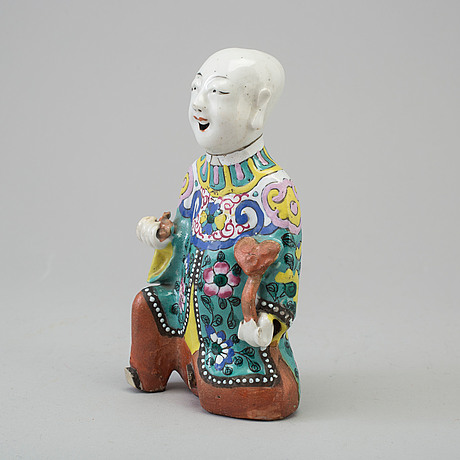 A porcelain figure of a laughing boy, qing dynasty, 19th century.