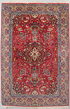 An oriental rug, signed, 300 x 202 cm.
