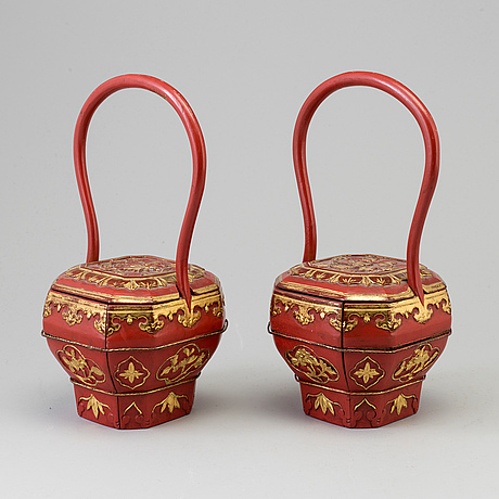 A pair of chinese red lacquered baskets, early 20th century.