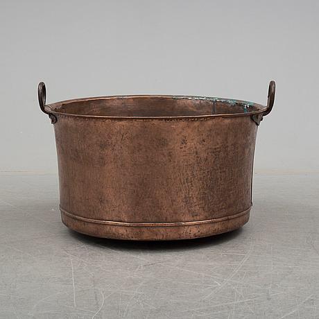 A 19th century copper cauldron