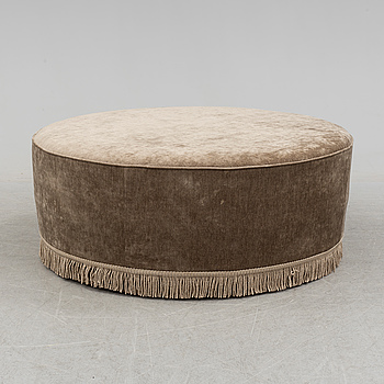 A 21st century upholstered foot stool by Gubi.