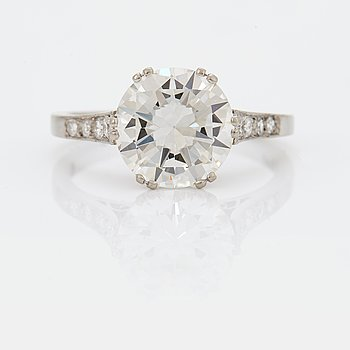 A SOLITAIRE RING with an old-cut diamond 2.56 cts.