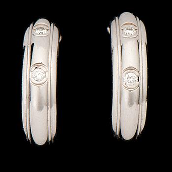 A PAIR OF EARRINGS, brilliant cut diamonds, 18K white gold. 'Possesion', Piaget.