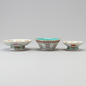 Two Chinese famille rose 'tri-gram' patterned footed dishes and one bowl, early 20th century.
