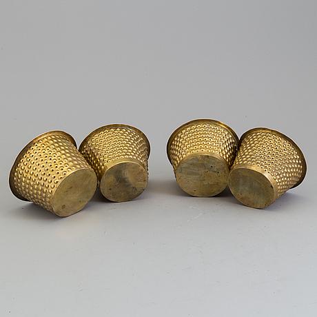 A set of four brass flower pots by josef frank for firma svenskt tenn