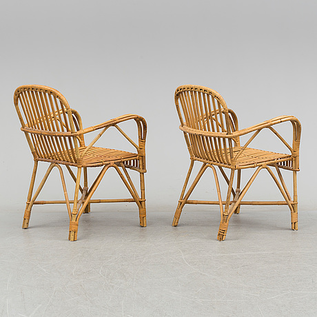 A pair of mid 20th century bamboo and rattan easy chairs