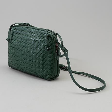 A green bottega veneta cross body  handbag