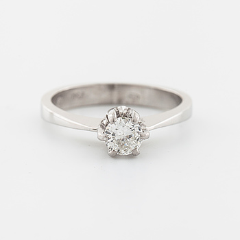 A brilliant cut diamond ring with swedsh import mark.