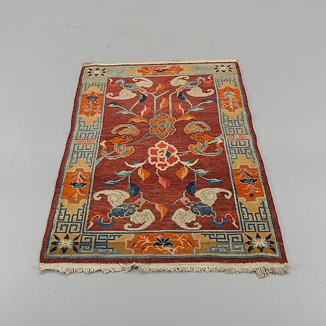 A semiantique chinese baotou carpet ca 147 x 91 cm.