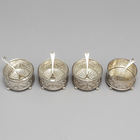 A set of four fabergé salt-cellars and spoons, marked moscow 1908-1917. imperial warrant.