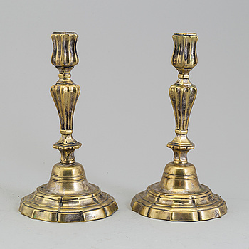 A pair of 18th century brass candlesticks.