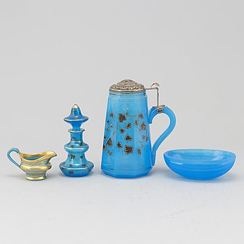 A silver gilt turkoise glass tankard, bottle with stopper, bowl and a small creamer, 19th Century.