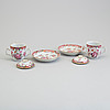 A pair of famille rose cups with covers and stands, qing dynasty, qianlong (1736-95).