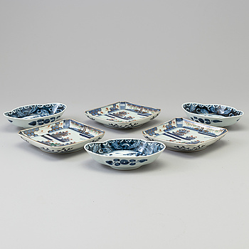 Three blue and white porcelain bowls and three trays, Japan, 20th century.