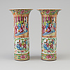 A pair of famille rose canton porcelain vases, qing dynasty, 19th century.