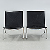 """A pair of """"pk22"""" chairs, designed by poul kjaerholm, made by fritz hansen in 1989."""