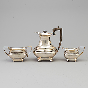 A three piece silver coffee set by The Alex Clark Company, London, first half of the 20th century.