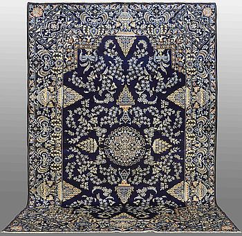 A CARPET, Kashan , signed, around 410 x 277 cm.