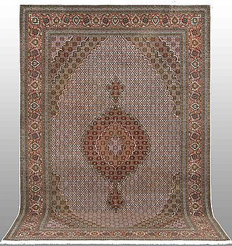 A CARPET, Tabriz, part silk so called 50 Radj, around 315 x 205 cm.