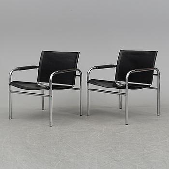 TORD BJÖRKLUND, a pair of 'Klinte' tubular steel easy chairs from IKEA.