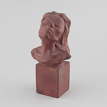 a plaster sculpture, signed.