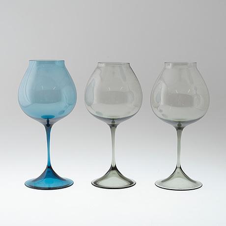 A set of three nils landberg glasses from orrefors.