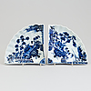A pair of japanese blue and white fan shaped dishes, edo period (1615–1868)