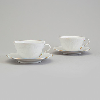 LOUISE ADELBORG, LOUISE ADELBORG, 12 porcelain 'Swedish Grace' tea cups and saucers from Rörstrand.