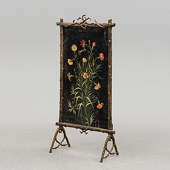 A cast iron fire screen, late 19th Century.