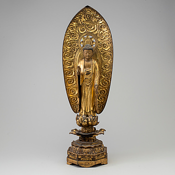 A large wooden lacquered figure of buddha, Japan, 19th Century.