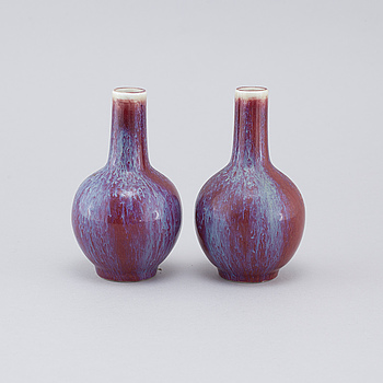 A pair of sang de boeuf vases, 20th cenutry.