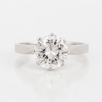 A brilliant-cut diamond solitaire ring.