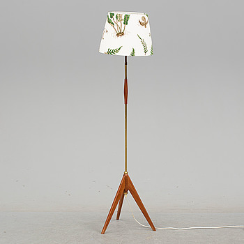 a teak and brass floor lamp, late 20th century.